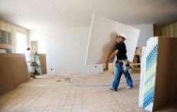 Как и чем крепить гипсокартон к стене?